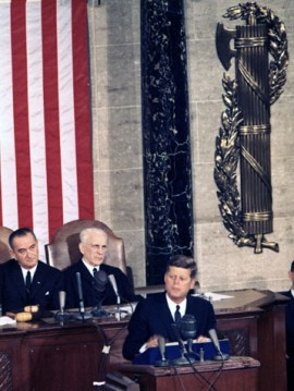 John F. Kennedy delivering a State of the Union address, with fasces immediately behind him.