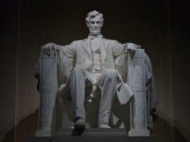 Abraham Lincoln by Daniel Chester French: Lincoln's hands rest on two large fasces.